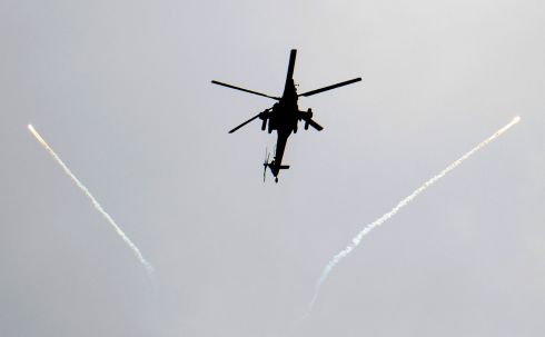 "MOSUL: An Iraqi forces' Mil Mi-28 ""Havoc"" helicopter fires flares in west Mosul during the ongoing battle by Iraqi forces to seize the city from Islamic State jihadists. Photograph: Christophe Simon/AFP/Getty Images"
