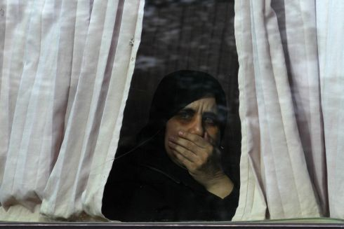 FREEDOM: A woman, who was detained by the Syrian government, arrives at insurgent-held al-Rashideen, Aleppo province, Syria, after her release. Photograph: Ammar Abdullah/Reuters