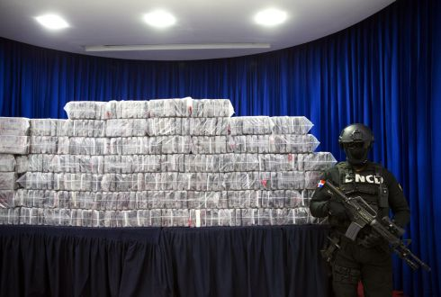 DOMINICAN REPUBLIC: Members of the National Drug Control Directorate (DNCD) display a shipment of 390 packets of drugs seized in Santo Domingo, Dominican Republic. Photograph: Orlando Barria/EPA