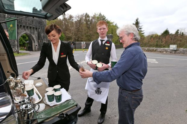 Ashford Castle staff bring hot chocolate and sweets out to the media the day before the wedding itself. Photograph: Colin Keegan/Collins Dublin