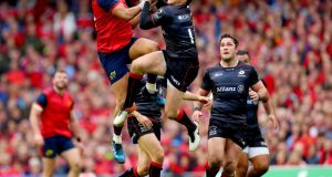 Simon Zebo and Alex Goode go for the high ball. Photograph: James Crombie/Inpho