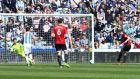 Fulham's Tom Cairney scores from the penalty spot at John Smith's Stadium. Photograph: Reuters
