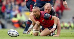 Simon Zebo is tackled by Schalk Burger during Munster's Champions Cup semi-final defeat to Saracens. Photograph: Dan Sheridan/Inpho