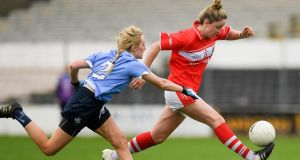Eimear Scally of Cork in action against Fiona Hudson of Dublin during the Lidl Ladies Football National League Division one  semi-final  at Nowlan Park in Kilkenny. Photograph:  Ray McManus/Sportsfile