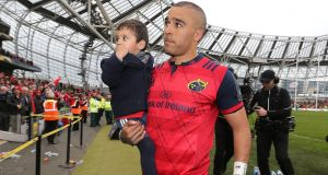 Munster's Simon Zebo with his son Jacob after the European Champions Cup, semi-final match against Saracens  at the Aviva Stadium. Photograph: Lorraine O'Sullivan/PA Wire