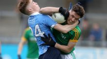 Dublin's David Lacey and Meath's Niall Mulvey in action during the Electric Ireland Leinster  MFC round one match at  Parnell Park. Photograph:  Bryan Keane/Inpho