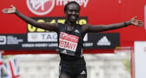Kenya's Mary Keitany celebrates after winning the women's elite race at the London Marathon. Photograph: Adrian Dennis/AFP/Getty Images
