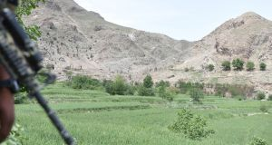 An  Afghan soldier patrols the area where US forces first used the  GBU-43 bomb  against caves used by Islamic State in   Nangahar province. Photograph:  EPA/Ghulamullah Habibi