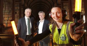 Provost, Dr Patrick Prendergast (left) and Ryanair CFO, Neil Sorahan, with Trinity business student Alannah Higgins from Boston. Photograph: Mark Stedman