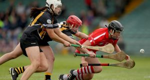 Kilkenny's Miriam Walsh and Danielle Morrissey challenge Cork's Aoife Murray during the Camogie League Division 1 title. Photograph: Donall Farmer/Inpho