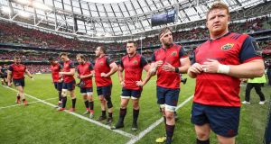 Dejected Munster players after the final whistle in the Aviva Stadium. Photograph: Billy Stickland/Ipho