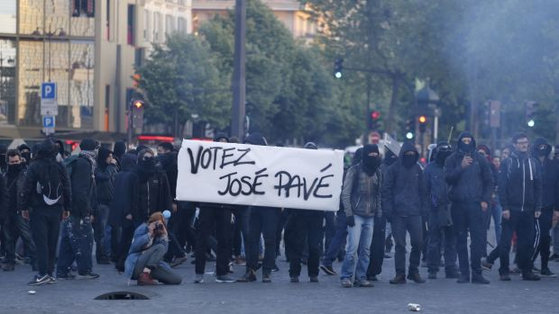 "Anti-fascists stand behind a banner reading ""Vote José Pavé (cobblestone)"" as they demonstrate in Paris on April 23rd, 2017 following the announcement of the results of the first round of the presidential election. Centrist Emmanuel Macron finished ahead of far-right leader Marine Le Pen. Photograph: Benjamin Cremel/AFP/Getty Images"