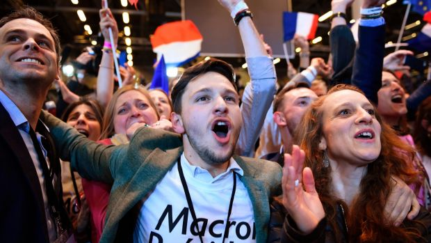 Supporters of Emmanuel Macron, French presidential election candidate for the En Marche! movement, celebrate after the results of the first round of the presidential election, on April 23rd, 2017 at the Parc des Expositions in Paris. Photograph: Eric Feferberg/AFP/Getty Images