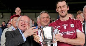 Galway captain David Burke receives the cup from President Michael D Higgins. Photograph: Donall Farmer/Inpho