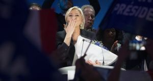 French presidential election candidate for the far-right Front National, Marine Le Pen, blows a kiss to the crowd during her   speech after finishing second in the first round of the  election in Henin-Beaumont, Northern France. Photograph: Olivier Hoslet/EPA