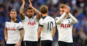Kyle Walker and Christian Eriksen applaud the Tottenham fans at Wembley. Photograph: Andy Rain/EPA
