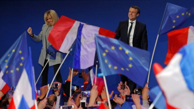 Celebrating: Emmanuel Macron, head of political movement En Marche! (Onwards!), and candidate for the 2017 French presidential election, on stage with his wife Brigitte Trogneux to speak at the Parc des Expositions hall in Paris after early results in the first round of the 2017 French presidential election. Photograph: Philippe Wojazer/Reuters