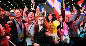 Supporters of Emmanuel Macron, French presidential election candidate for the En Marche! movement, celebrate after the results of the first round of the presidential election,  at the Parc des Expositions in Paris. Photograph: Eric Feferberg/AFP/Getty Images