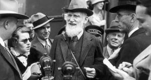 George Bernard Shaw on a visit in Los Angeles answering questions from the American journalists around him. Photograph:  Keystone-France/Gamma-Keystone via Getty Images