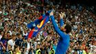 Lionel Messi celebrates his late winner with the travelling Barcelona fans. Photograph: Getty Images