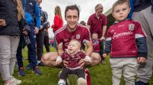 Galway captain David Burke celebrates with the Division One trophy, with his neice and nephew. Photograph: Inpho