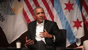 Former US president Barack Obama speaks during a forum at the University of Chicago held to promote community organising, his   first formal public appearance since leaving office. Photograph: Getty