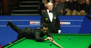 Ronnie O'Sullivan in action against Ding Junhui on day eleven at the Crucible. Photograph: PA