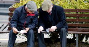 Two racegoers study their racecards at Punchestown racecourse on Tuesday. Photograph: Getty Images