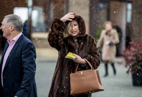 Hold on to your hats. Racegoers arrive to bad weather in Naas. Photograph: Inpho