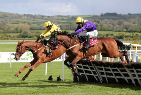 Jockey Jack Kennedy on board Cilaos Emery, about to go past Melon to win the  Herald Champion Novice Hurdle. Photograph: PA