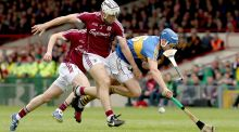 Galway's Daithí Burke loses his hurl as he battles for possession with Tipperary's John McGrath in the league final in Limerick. Photograph: Donall Farmer/Inpho