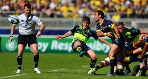 Clermont's Morgan Parra and Luke McGrath of Leinster. Photograph: James Crombie/Inpho