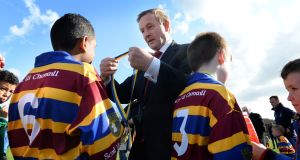 Scoil Uí Chonaill: Enda Kenny presents medals to young members of the GAA club, who played St Laurence O'Toole at the club's new facilities. Photograph: Dara Mac Dónaill