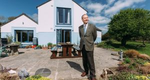 "Paul Conway at his home in  Co Clare. He regrets putting in timber window frames ""as living in the Irish countryside, the wood takes a lot of battering from the weather and the frames have to be repainted every year"". Photograph: Eamon Ward"