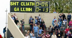 Fans interfere with the scoreboard during the All-Ireland under-21 final of 2002. Galway defeated Dublin by 0-15 to 0-7. Photograph: Morgan Treacy/Inpho