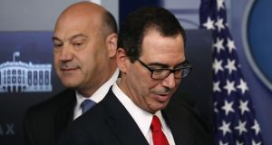 US national economic director Gary Cohn and treasury secretary Steven Mnuchin unveil the Trump administration's tax reform proposal in the White House on Wednesday. Photograph: Carlos Barria/Reuters