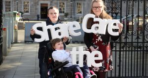 Sam Kratschmar, Una McNicholas, Dublin Young Carer of the Year and Jessica Walsh (9) who has Retts Syndrome, pictured outside Leinster House, Dublin, as Family Carers Ireland launch 'Share the Care' campaign and highlighting vital role carers play in society. Photograph: Dara Mac Dónaill / The Irish Times