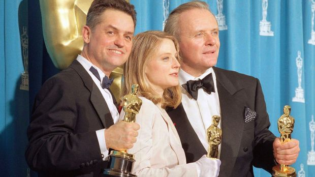 Jonathan Demme holds the Oscar for best director, alongside Jodie Foster (best actress) and Anthony Hopkins (best actor) for The Silence of the Lambs. Photograph: Reed Saxon/AP