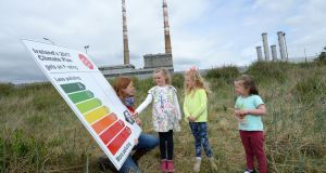 "Kate Ruddock of Stop Climate Chaos with sisters Laoise (8), Aisling (6) and Róisín Ó Moráin, from Sandymount, supporting environmentalists who gave Minister for Energy Denis Naughten's draft climate action plan an ""F"". Photograph: Dara Mac Dónaill"