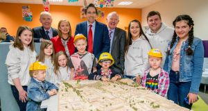 CHILDREN'S HOSPITAL: Building work on the new National Children's Hospital is set to begin within weeks. Minister for Health Simon Harris (centre), with group chief executive of the Children's Hospital Eilish Hardiman (red jacket) and project director John Pollock, (fifth from right)  at St James's Hospital, Dublin, for the announcement. Photograph: Brenda Fitzsimons/The Irish Times