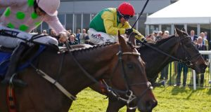 Robbie Power riding Sizing John (right) wins the  The Coral Punchestown Gold Cup from Djakadam  at Punchestown.  Photograph: Alan Crowhurst/Getty Images