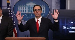 US treasury secretary Steven Mnuchin ends a briefing at the White House after unveiling the Trump administration's proposal to cut corporation tax from 35 per cent to 15 per cent.  Photograph: Carlos Barria/Reuters