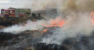 Firefighters at the scene of a raging gorse fire in West Cork. Photograph: Cork County Fire Service/PA Wire