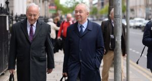 Nicholas Kearns (right), the former High Court president and deputy chairman of the NMH, arriving at the National Maternity Hospital, Holles Street, this week. Photograph: Dara Mac Dónaill