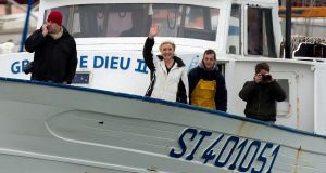 French presidential  candidate  Marine Le Pen meets fishermen in the harbour of Le Grau-du-Roi. Photograph: Bertrand Langlois/AFP/Getty Images