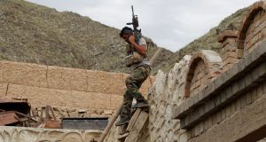 An  Afghan special forces unit member inspects a house which was used by suspected Islamic State militants at the site where a massive US bomb struck, in the Achin district of the eastern province of Nangarhar, earlier this month. Photograph:  Parwiz/Reuters
