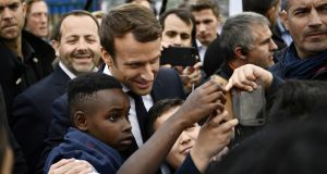 French presidential candidate Emmanuel Macron poses for a selfie during a campaign visit in Sarcelles, Paris. Photograph: Martin Bureau/Reuters