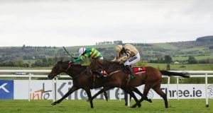 Noel  Fehily on board Unowhatimeanharry pips Nichols Canyon and Ruby Walsh to win the Ladbrokes Champion Stayers Hurdle at Punchestown. Photograph: Ryan Byrne/Inpho
