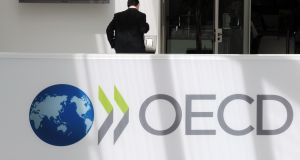Outflows from the OECD area and the EU decreased by 9 per cent and 10 per cent respectively, partly driven by flows from Ireland and Switzerland. Photograph: AFP/Getty Images