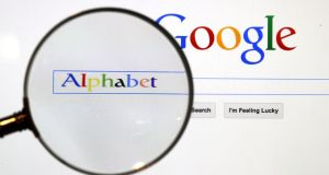 A Google search page is seen through a magnifying glass. Photograph: REUTERS/Pawel Kopczynski